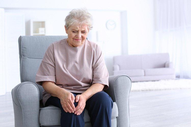 elderly woman pain joints ache